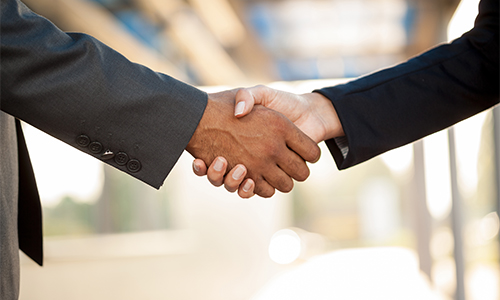 A handshake representing the collaboration required to achieve APWA's public policy priorities